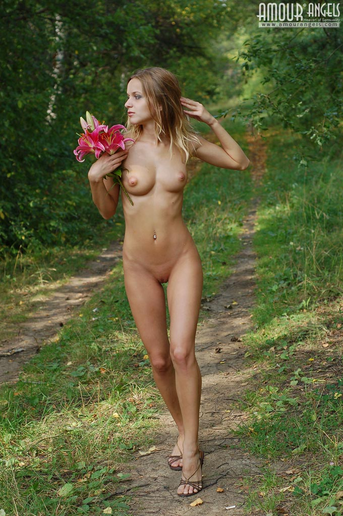 Beauty walks around the garden shows her meaty hairy pussy 9