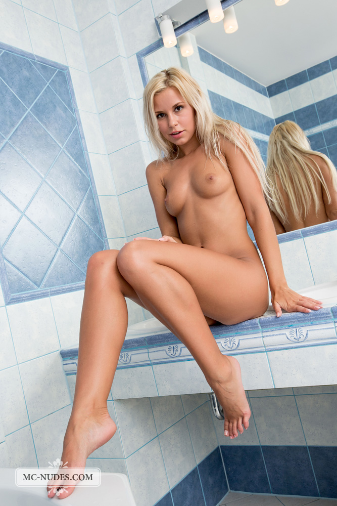 spreading her long legs and having fun in her bathroom ...