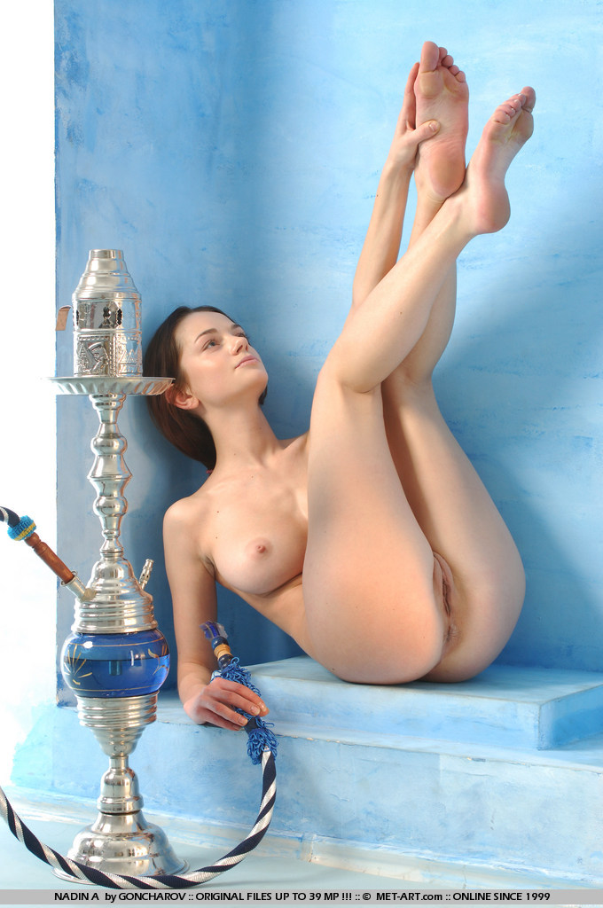 Hot young girl nadin stripping and playing with her toy
